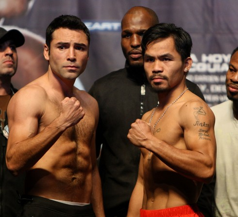 LAS VEGAS - DECEMBER 05:  (L-R) Oscar De La Hoya and Manny Pacquiao of the Philippines pose during the weigh-in for their welterweight fight at the MGM Grand Garden Arena December 5, 2008 in Las Vegas, Nevada. De La Hoya fights Pacquiao December 6th.  (Photo by Jed Jacobsohn/Getty Images) ORG XMIT: 83767266 GTY ID: 67266MW020_Oscar_De_La_H