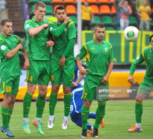 GRODNO,BELARUS - JUNE 15:   The FC Neman Grodno players defend a free kick during the Belarusian Premier League match between FC Neman Grodno and FC Dinamo Minsk at the Neman Stadium on June 15,2014 in Grodno,Belarus. (Photo by Viktor Drachev/EuroFootball/Getty Images)