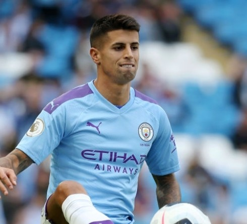 MANCHESTER, ENGLAND - AUGUST 17: Joao Cancelo of Manchester City warms up prior to the Premier League match between Manchester City and Tottenham Hotspur at Etihad Stadium on August 17, 2019 in Manchester, United Kingdom. (Photo by Matt McNulty - Manchester City/Manchester City FC via Getty Images)