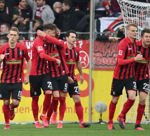 FREIBURG IM BREISGAU, GERMANY - MARCH 07: Robin Koch of Sport-Club Freiburg celebrates with teammates after scoring his sides third goal during the Bundesliga match between Sport-Club Freiburg and 1. FC Union Berlin at Schwarzwald-Stadion on March 07, 2020 in Freiburg im Breisgau, Germany. (Photo by Matthias Hangst/Bongarts/Getty Images)