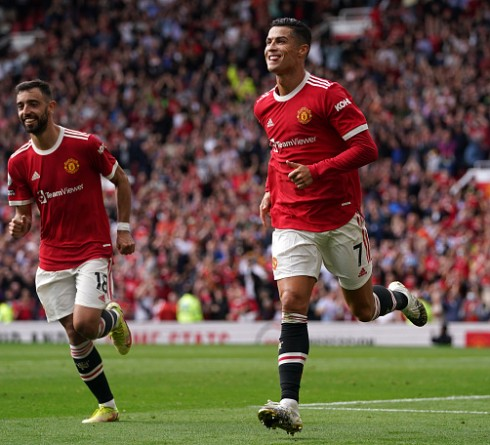 Manchester United's Cristiano Ronaldo celebrates scoring their side's first goal of the game during the Premier League match at Old Trafford, Manchester. Picture date: Saturday September 11, 2021. (Photo by Martin Rickett/PA Images via Getty Images)