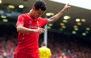 LIVERPOOL, ENGLAND - Sunday, August 10, 2014: Liverpool's Philippe Coutinho Correia celebrates scoring the third goal against Borussia Dortmund during a preseason friendly match at Anfield. (Pic by David Rawcliffe/Propaganda)